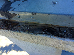 This roof had a leak in the flashing around the cimney and as a result was completely rotten