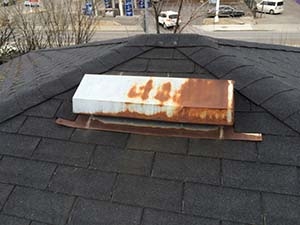 Rusty flashing is causing a leak on this Calgary roof